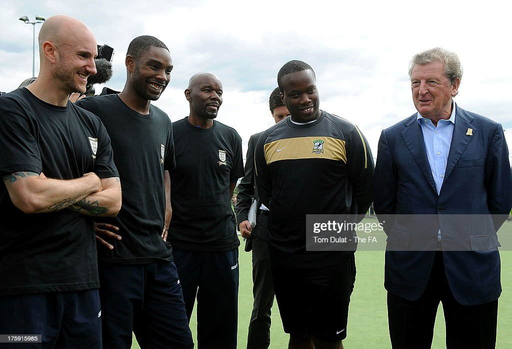 Manager of the English national football team <a gi-track='captionPersonalityLinkClicked' href=/galleries/search?phrase=Roy+Hodgson&family=editorial&specificpeople=881703 ng-click='$event.stopPropagation()'>Roy Hodgson</a> speaks to the coaches during The FA's Sir Bobby Robson National Football Day at Kings College Sports Ground on August 10, 2013 in London, England.