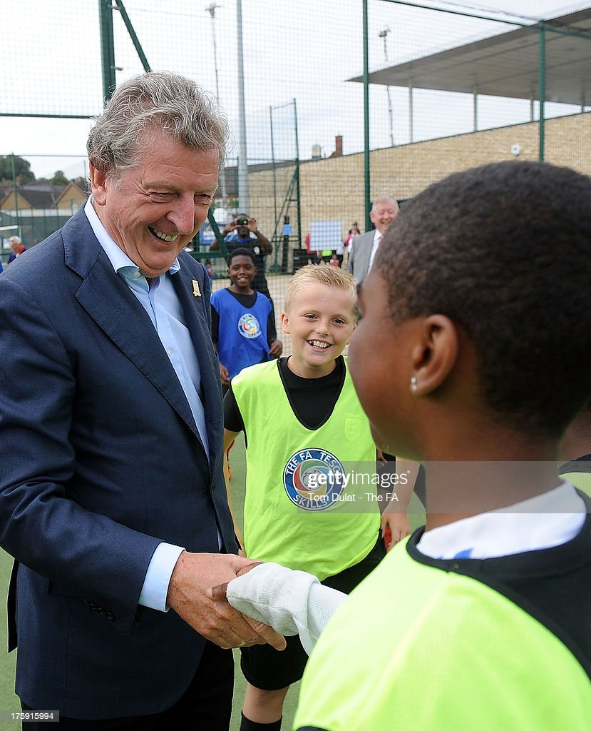 Manager of the English national football team <a gi-track='captionPersonalityLinkClicked' href=/galleries/search?phrase=Roy+Hodgson&family=editorial&specificpeople=881703 ng-click='$event.stopPropagation()'>Roy Hodgson</a> speaks to children during The FA's Sir Bobby Robson National Football Day at Kings College Sports Ground on August 10, 2013 in London, England.