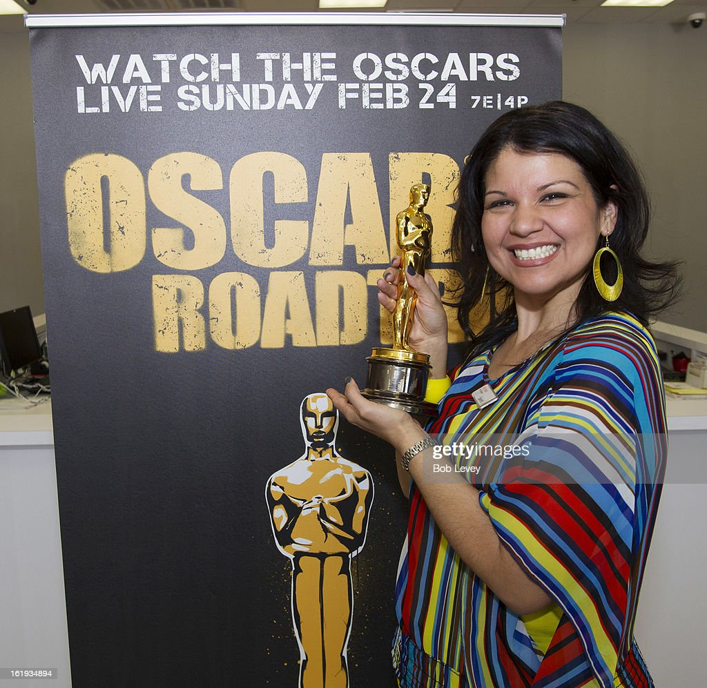 Manager of the Sprint Store in Town & Country Center Cindi Simms holds the Oscar statue during the First-Ever Oscar Roadtrip on February 17, 2013 in Houston, Texas.