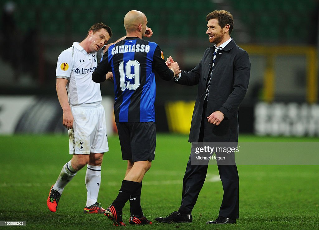 Manager of Tottenham Hotspur Andre Villas-Boas shakes hands with Esteban Cambiasso of Inter Milan after the UEFA Europa League Round of 16 second leg match between Inter Milan and Tottenham Hotspur at San Siro Stadium on March 14, 2013 in Milan, Italy. Tottenham Hotspur progress on the away goals rule.