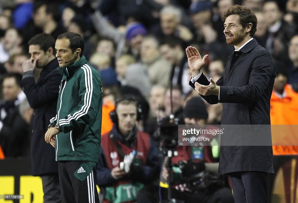 Manager of Tottenham Hotspur's Portugese Manager Andre Villas-Boas applauds his players during the Europa League Round of 32 football match between Tottenham Hotspur and Lyon at White Hart Lane in London, England, on February 14, 2013. Tottenham Hotspur won 2-1. AFP PHOTO / IAN KINGTON