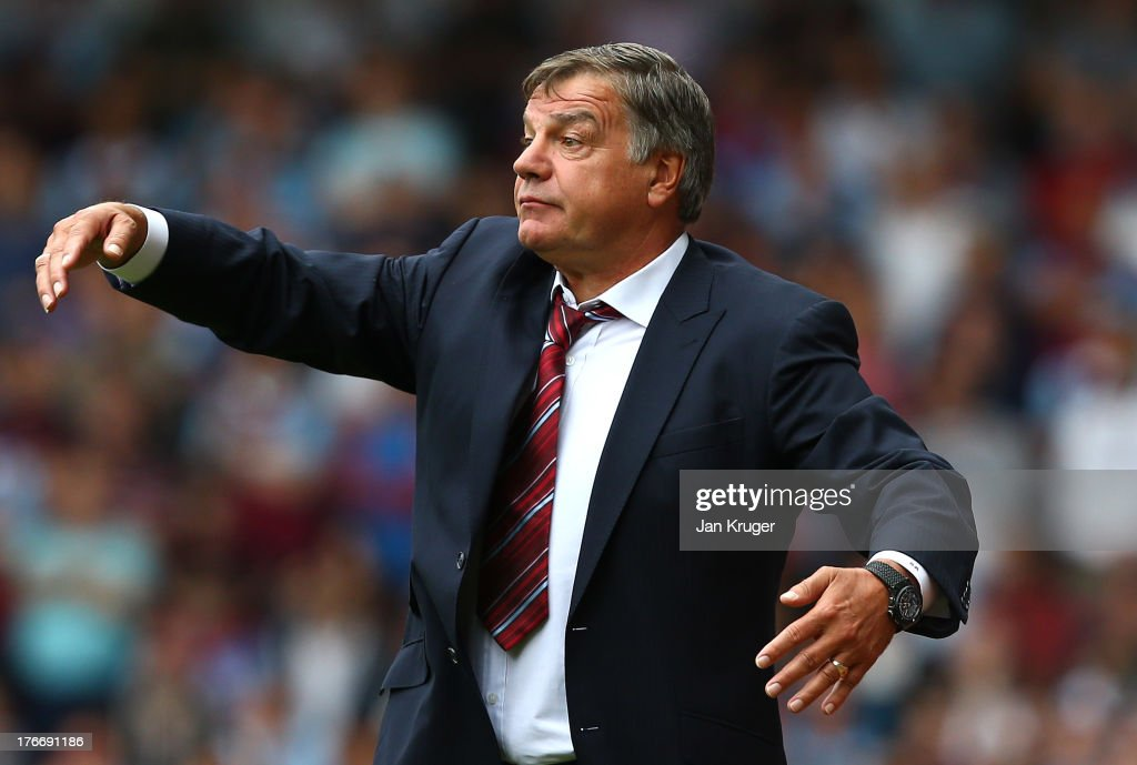 Manager of West Ham <a gi-track='captionPersonalityLinkClicked' href=/galleries/search?phrase=Sam+Allardyce&family=editorial&specificpeople=214691 ng-click='$event.stopPropagation()'>Sam Allardyce</a> directs the team during the Barclays Premier League match between West Ham United and Cardiff City at the Bolyen Ground on August 17, 2013 in London, England.