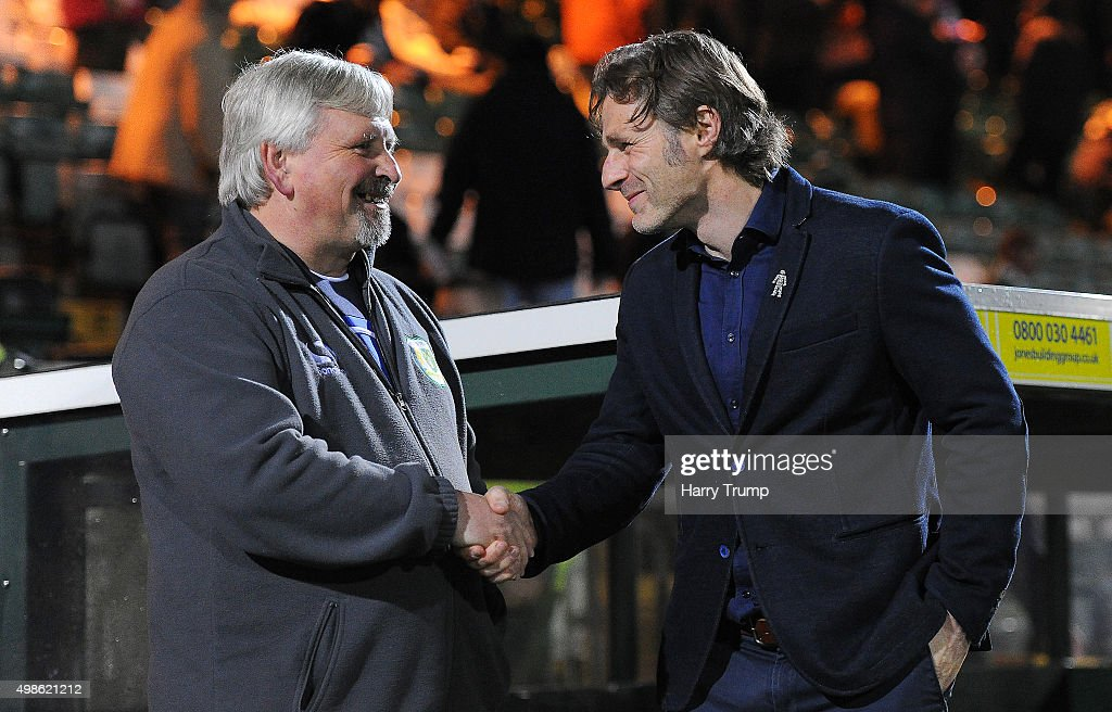 Manager of Yeovil Town Paul Sturrock shakes hands with Wycombe Wanderers Manager Gareth Ainsworth during the Sky Bet League Two match between Yeovil...
