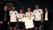 Manager Oliver Bierhoff Michael Ballack Philipp Lahm Bastian Schweinsteiger Per Mertesacker and head coach Joachim Loew present the new German FIFA...