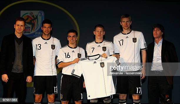 Manager Oliver Bierhoff Michael Ballack Philipp Lahm Bastian Schweinsteiger Per Mertesacker and head coach Joachim Loew present the new German FIFA...