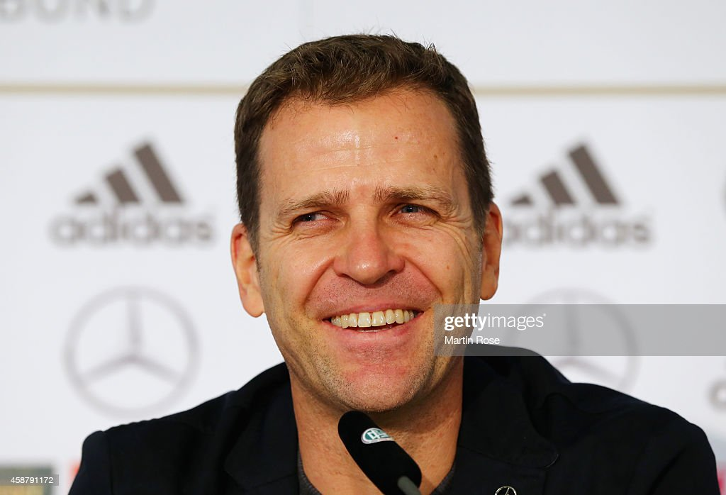Manager <a gi-track='captionPersonalityLinkClicked' href=/galleries/search?phrase=Oliver+Bierhoff&family=editorial&specificpeople=213661 ng-click='$event.stopPropagation()'>Oliver Bierhoff</a> of Germany laughs during a press conference ahead of their EURO 2016 Group D qualifying match against Gibraltar on November 11, 2014 in Berlin, Germany.