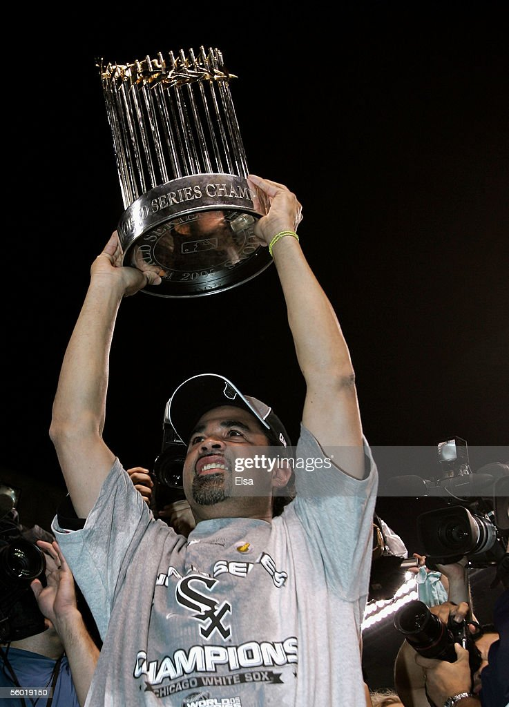 Manager Ozzie Guillen of the Chicago White Sox celebrates with the Championship trophy after winning Game Four of the 2005 Major League Baseball...