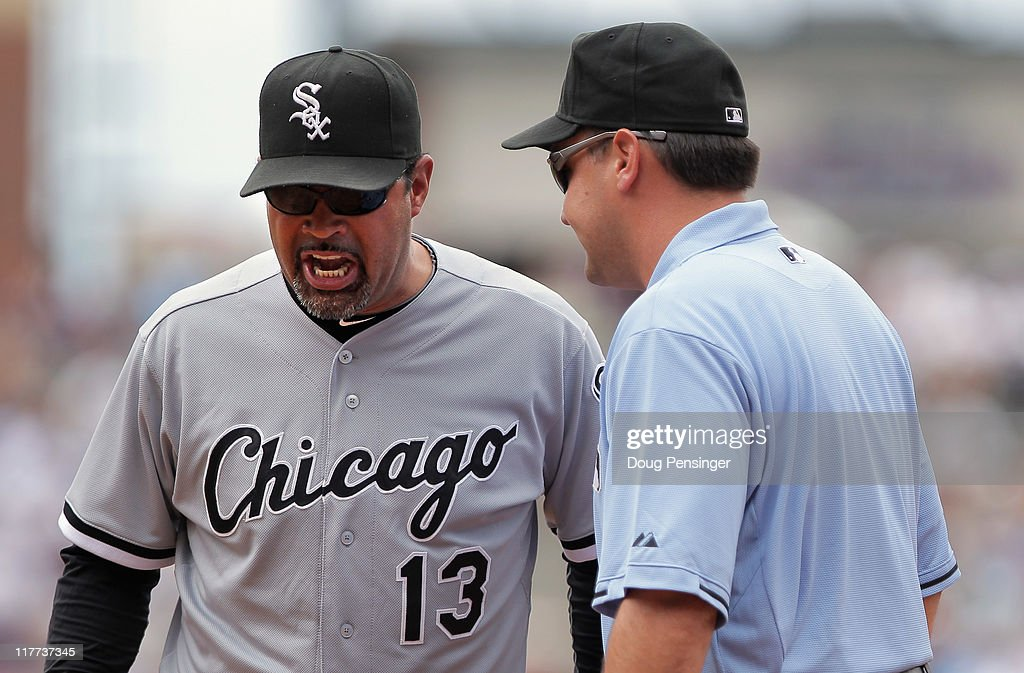 Manager <a gi-track='captionPersonalityLinkClicked' href=/galleries/search?phrase=Ozzie+Guillen&family=editorial&specificpeople=210514 ng-click='$event.stopPropagation()'>Ozzie Guillen</a> #13 of the Chicago White Sox protests a call with first base umpire Vic Carapazza after Seth Smith of the Colorado Rockies was called safe at first on a ground ball to first baseman Adam Dunn of the White Sox in the third inning during Interleague play at Coors Field on June 30, 2011 in Denver, Colorado.