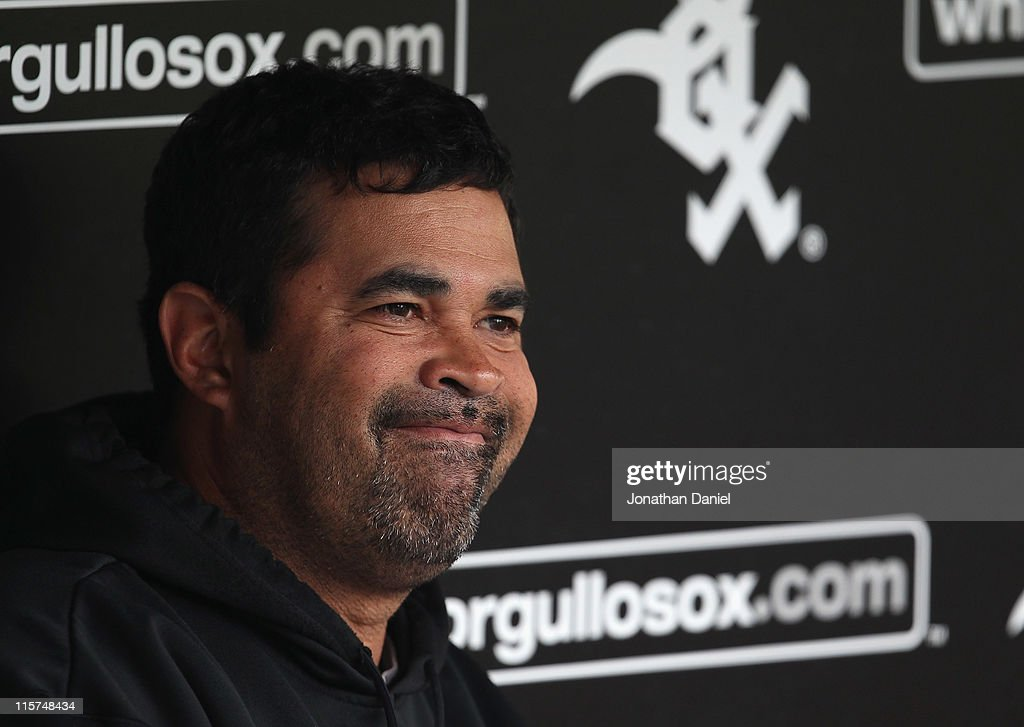 Manager <a gi-track='captionPersonalityLinkClicked' href=/galleries/search?phrase=Ozzie+Guillen&family=editorial&specificpeople=210514 ng-click='$event.stopPropagation()'>Ozzie Guillen</a> #13 of the Chicago White Sox talks with reporters before a game against the Oakland Athletics at U.S. Cellular Field on June 9, 2011 in Chicago, Illinois.