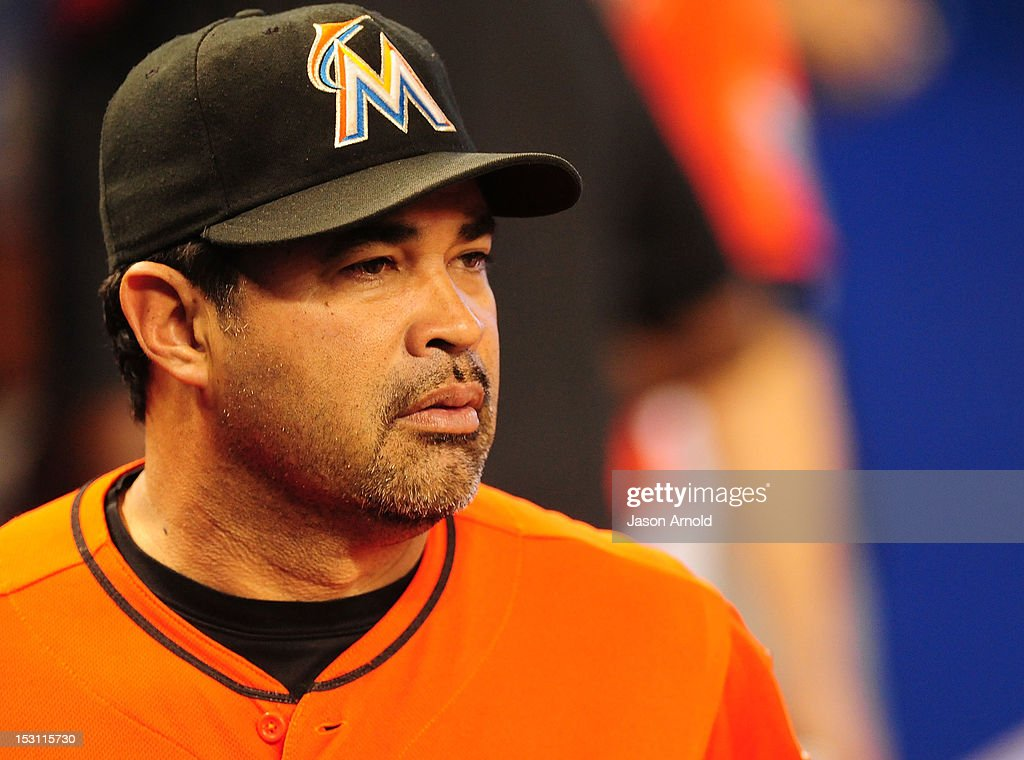 Manager <a gi-track='captionPersonalityLinkClicked' href=/galleries/search?phrase=Ozzie+Guillen&family=editorial&specificpeople=210514 ng-click='$event.stopPropagation()'>Ozzie Guillen</a> #13 of the Miami Marlins looks on prior to MLB action against thePhiladelphia Phillie at Marlins Park on September 30, 2012 in Miami, Florida.