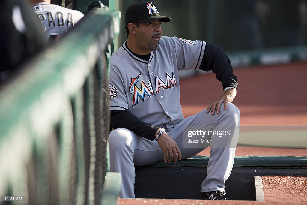 Manager <a gi-track='captionPersonalityLinkClicked' href=/galleries/search?phrase=Ozzie+Guillen&family=editorial&specificpeople=210514 ng-click='$event.stopPropagation()'>Ozzie Guillen</a> #13 of the Miami Marlins watches the game from the dugout during the seventh inning against the Cleveland Indians at Progressive Field on May 19, 2012 in Cleveland, Ohio.