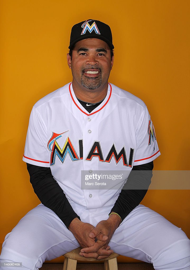 Manager Ozzie Gullen #13 of the Miami Marlins poses for photos during media day at Roger Dean Stadium on February 27, 2012 in Jupiter, Florida.