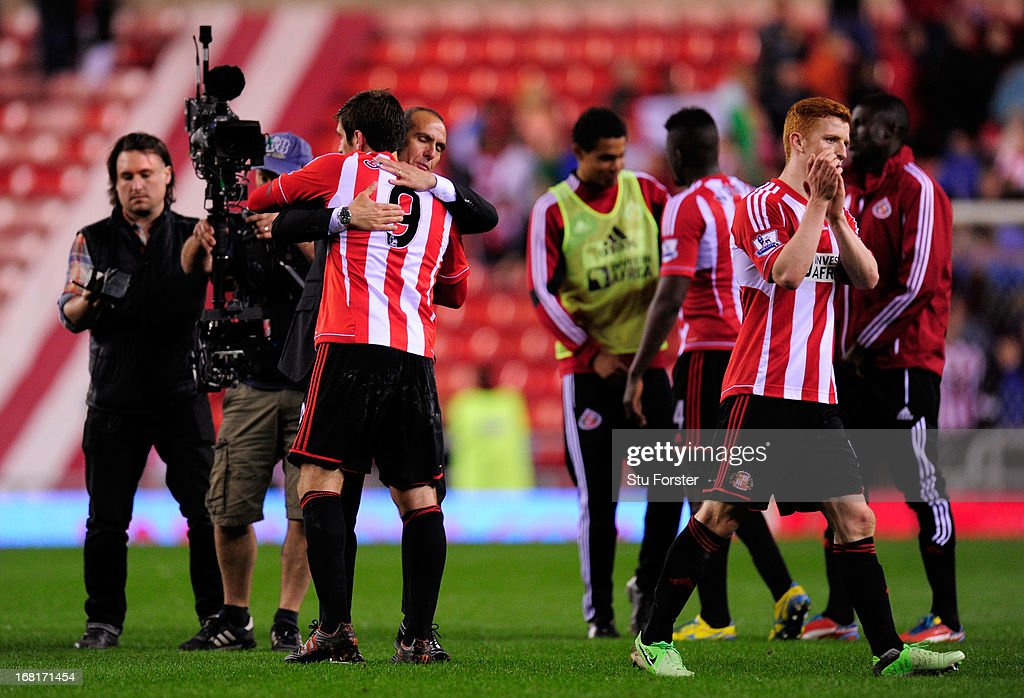Manager <a gi-track='captionPersonalityLinkClicked' href=/galleries/search?phrase=Paolo+Di+Canio&family=editorial&specificpeople=215237 ng-click='$event.stopPropagation()'>Paolo Di Canio</a> of Sunderland hugs Danny Graham of Sunderland at the final whistle as <a gi-track='captionPersonalityLinkClicked' href=/galleries/search?phrase=Jack+Colback&family=editorial&specificpeople=4940395 ng-click='$event.stopPropagation()'>Jack Colback</a> of Sunderland (R) applauds the fansduring the Barclays Premier League match between Sunderland and Stoke City at the Stadium of Light on May 06, 2013 in Sunderland, England.