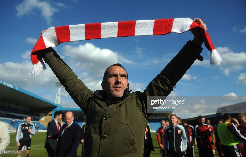 Manager Paolo Di Canio of Swindon celebrates their promotion during the npower League 2 match between Gillingham and Swindon Town at Priestfield...
