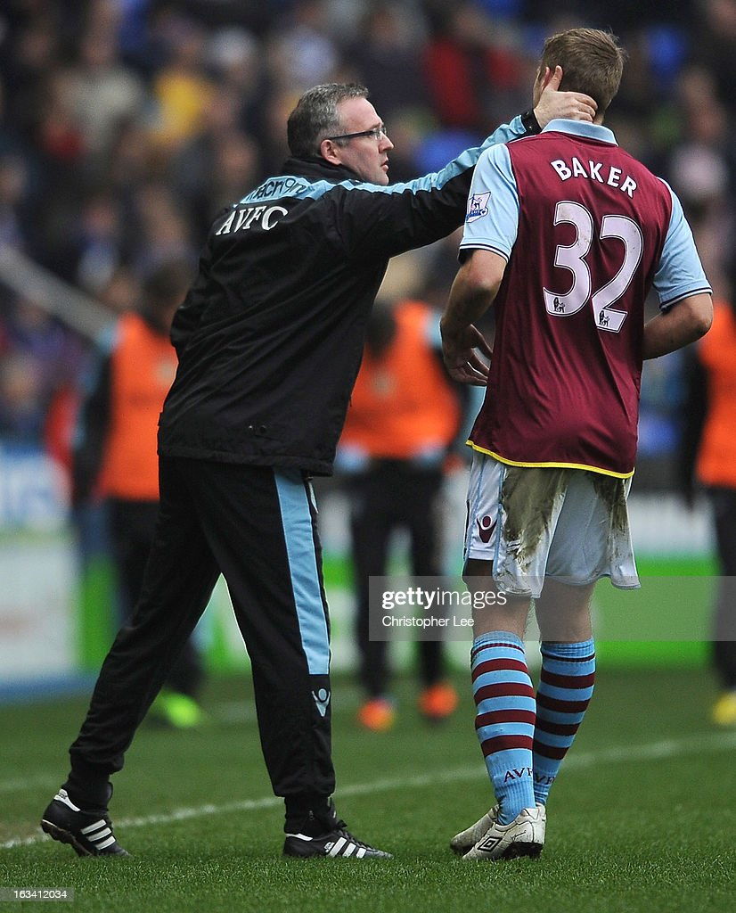 Manager Paul Lambert has a quick word with Nathan Baker after he scored an own goal during the Barclays Premier League match between Reading and Aston Villa at Madejski Stadium on March 9, 2013 in Reading, England.