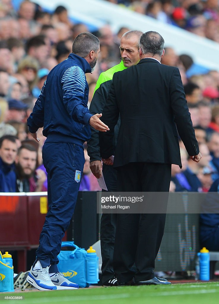 Manager Paul Lambert (R) of Aston Villa and assistant Roy Keane exchange words with fourth official Martin Atkinson during the Barclays Premier League match between Aston Villa and Newcastle United at Villa Park on August 23, 2014 in Birmingham, England.