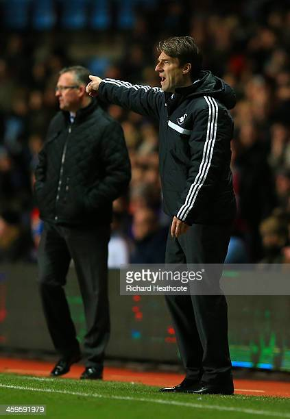 Manager Paul Lambert of Aston Villa and Michael Laudrup manager of Swansea City on the touchline during the Barclays Premier League match between...