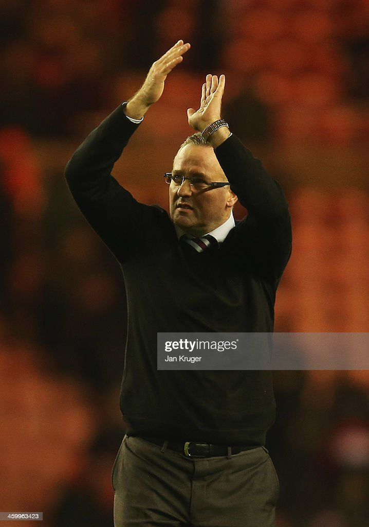 Manager Paul Lambert of Aston Villa salutes the travelling fans after victory in the Barclays Premier League match between Sunderland and Aston Villa at Stadium of Light on January 1, 2014 in Sunderland, England.