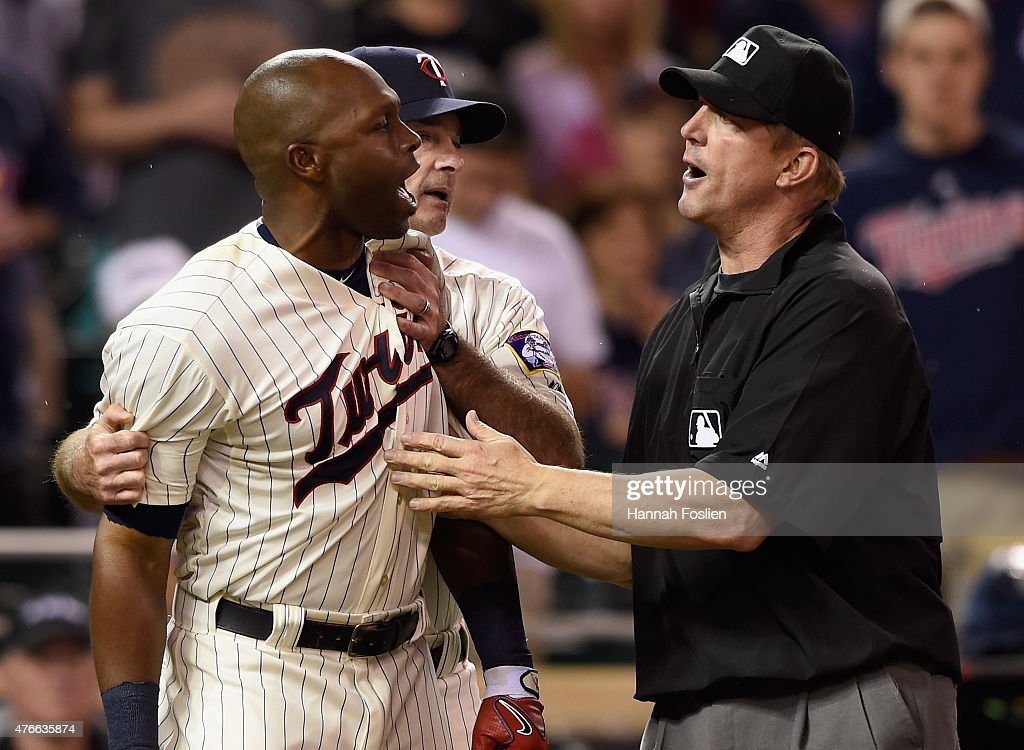 Manager Paul Molitor #4 of the Minnesota Twins and first base umpire Jeff Kellogg #8 get between Torii Hunter #48 and home plate umpire Mark Ripperger #90 (not pictured) after Hunter and Molitor were ejected from the game following a called third strike during the eighth inning against the Kansas City Royals on June 10, 2015 at Target Field in Minneapolis, Minnesota. The Royals defeated the Twins 7-2.