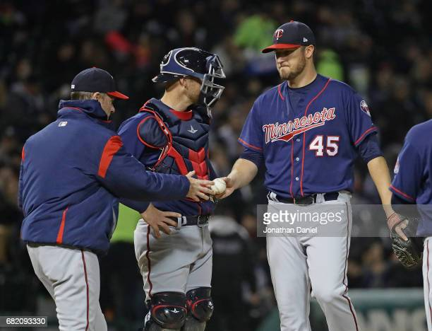 Manager Paul Molitor of the Minnesota Twins take starting pitcher Phil Hughes out of the game in the 5th inning against the Chicago White Sox at...