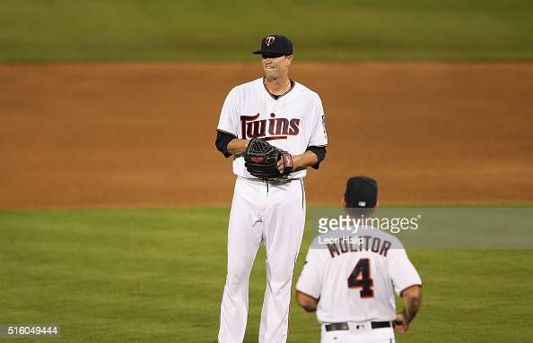 Manager Paul Molitor of the Minnesota Twins walks to the mound to make a pitching change replace starting pitcher Kyle Gibson during the fourth...