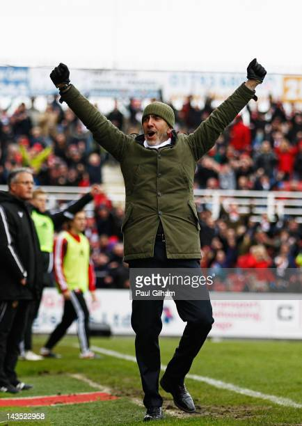 Manager Paulo Di Canio of Swindon Town celebrates at the final whistle after Swindon Town were crownded champions during the npower League Two match...