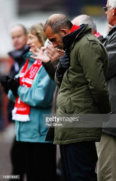 Manager Paulo Di Canio of Swindon Town observes a minutes silence prior to the start of the npower League Two match between Swindon Town and Port...