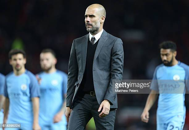 Manager Pep Guardiola of Manchester City walks off after the EFL Cup Fourth Round match between Manchester United and Manchester City at Old Trafford...