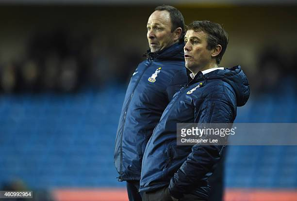 Manager Phil Parkinson of Bradford and his assistant Steve Parkin pulls faces as they watch their team miss a chance to score during the FA Cup Third...