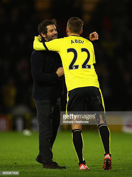Manager Quique Flores and Almen Abdi of Watford celebrate their team's 20 win in the Barclays Premier League match between Watford and Norwich City...