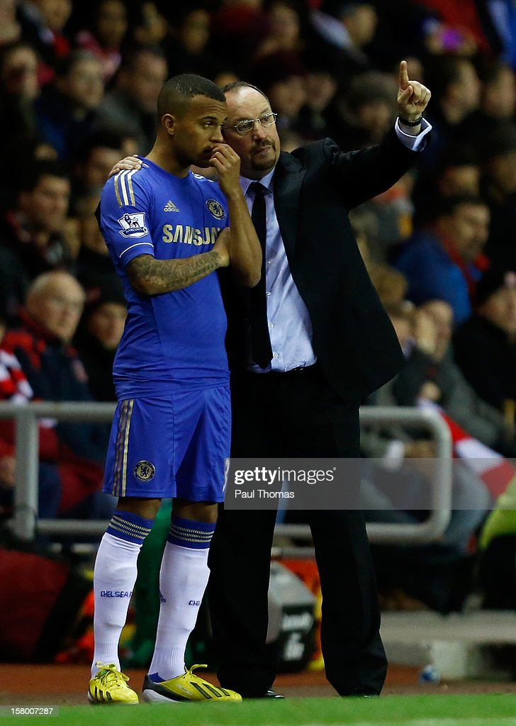 Manager Rafa Benitez of Chelsea speaks to his player <a gi-track='captionPersonalityLinkClicked' href=/galleries/search?phrase=Ryan+Bertrand+-+Soccer+Player&family=editorial&specificpeople=1820135 ng-click='$event.stopPropagation()'>Ryan Bertrand</a> (L) before he goes on during the Barclays Premier League match between Sunderland and Chelsea at the Stadium of Light on December 8, 2012, in Sunderland, England.