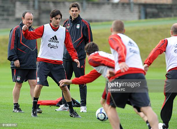 Manager Rafael Benitez looks on as new signing Alberto Aquilani trains on the ball for the first time during a Liverpool Training session at Melwood...