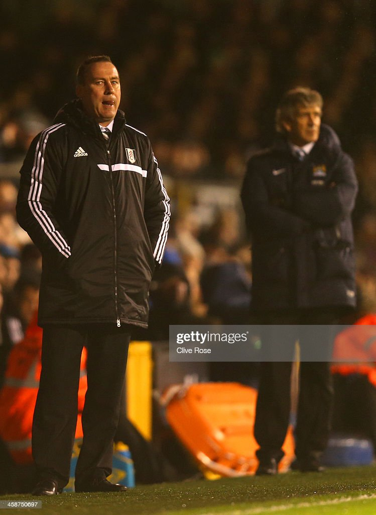 Manager <a gi-track='captionPersonalityLinkClicked' href=/galleries/search?phrase=Rene+Meulensteen&family=editorial&specificpeople=554528 ng-click='$event.stopPropagation()'>Rene Meulensteen</a> of Fulham looks on during the Barclays Premier League match between Fulham and Manchester City at Craven Cottage on December 21, 2013 in London, England.