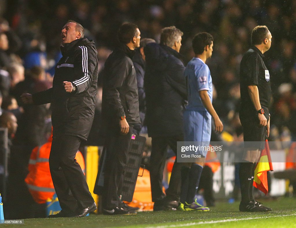 Manager <a gi-track='captionPersonalityLinkClicked' href=/galleries/search?phrase=Rene+Meulensteen&family=editorial&specificpeople=554528 ng-click='$event.stopPropagation()'>Rene Meulensteen</a> of Fulham (L) reacts during the Barclays Premier League match between Fulham and Manchester City at Craven Cottage on December 21, 2013 in London, England.