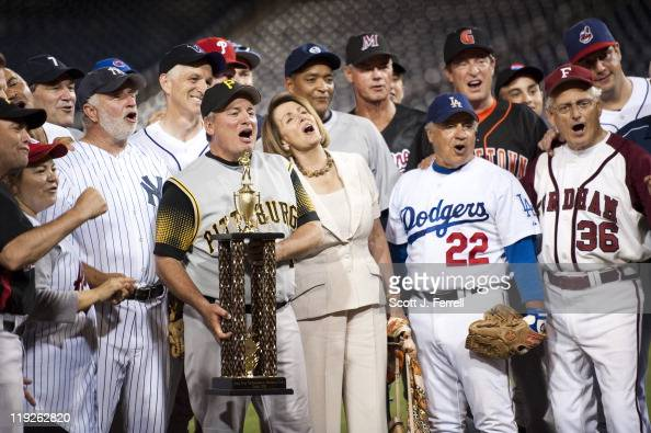 Manager Rep Mike Doyle DPa with trophy House Minority Leader Nancy Pelosi DCalif and the Democratic team celebrate their victory after the 50th...