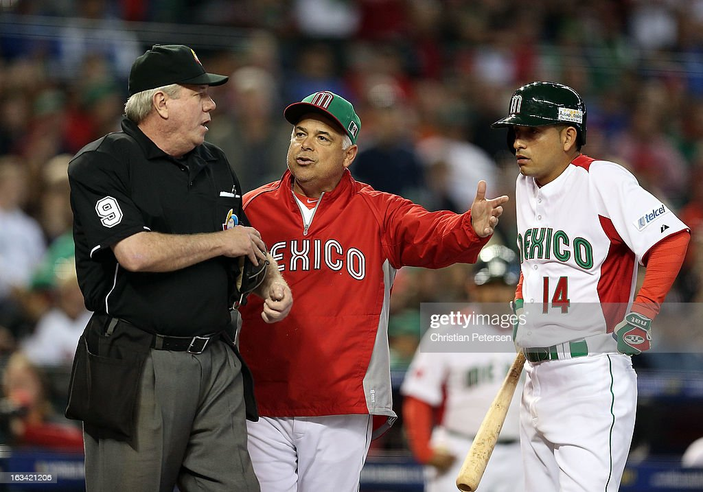 Manager Rick Renteria of Mexico argues with home plate umpire Brian Gorman after Eduardo Arredondo #14 claimed to have been interfered by catcher Chris Robinson (not pictured) of Canada during the World Baseball Classic First Round Group D game at Chase Field on March 9, 2013 in Phoenix, Arizona.