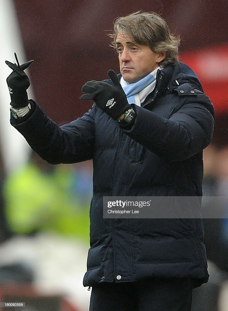 Manager <a gi-track='captionPersonalityLinkClicked' href=/galleries/search?phrase=Roberto+Mancini&family=editorial&specificpeople=234429 ng-click='$event.stopPropagation()'>Roberto Mancini</a> of Man City gives directions to his players while not wearing his gloves properly and having floppy fingers during the FA Cup Fourth Round match between Stoke City and Manchester City at Britannia Stadium on January 26, 2013 in Stoke on Trent, England.