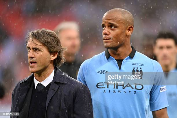 Manager Roberto Mancini of Manchester City and Vincent Kompany look dejected in defeat after the FA Cup with Budweiser Final between Manchester City...
