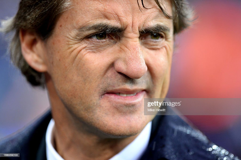 Manager Roberto Mancini of Manchester City looks dejected in defeat after the FA Cup with Budweiser Final between Manchester City and Wigan Athletic at Wembley Stadium on May 11, 2013 in London, England.