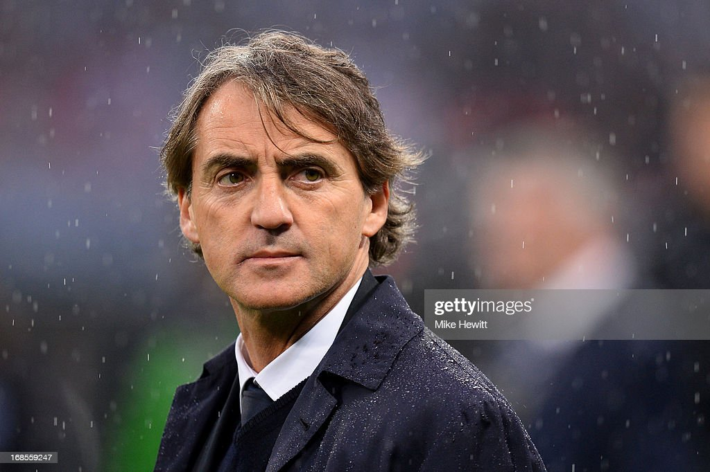 Manager <a gi-track='captionPersonalityLinkClicked' href=/galleries/search?phrase=Roberto+Mancini&family=editorial&specificpeople=234429 ng-click='$event.stopPropagation()'>Roberto Mancini</a> of Manchester City looks dejected in defeat after the FA Cup with Budweiser Final between Manchester City and Wigan Athletic at Wembley Stadium on May 11, 2013 in London, England.