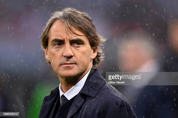 Manager Roberto Mancini of Manchester City looks dejected in defeat after the FA Cup with Budweiser Final between Manchester City and Wigan Athletic...