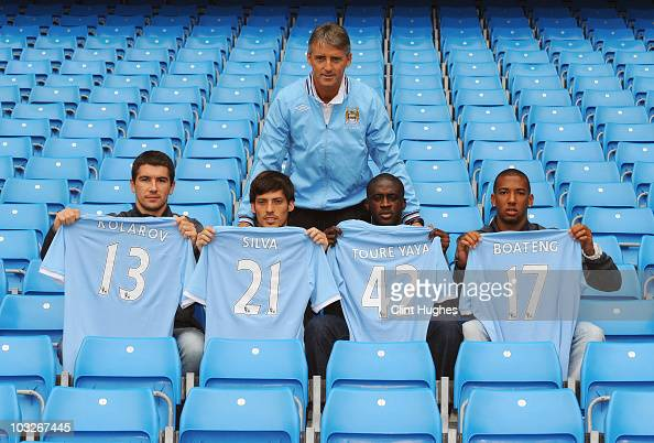 Manager Roberto Mancini poses with new signings Aleksandar Kolarov David Silva Yaya Toure and Jerome Boateng during a Manchester City training...