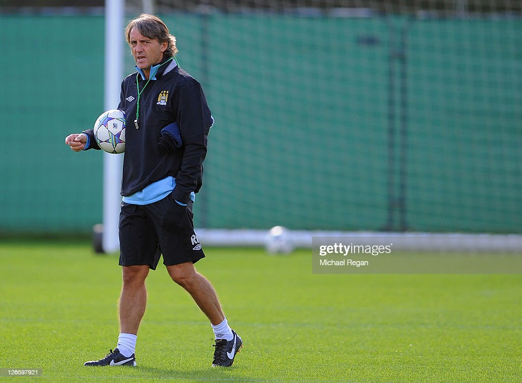 Manager Roberto Mancini supervises a Manchester City training session ahead of their UEFA Champions League Group A match against Bayern Munich on September 26, 2011 in Manchester, United Kingdom.