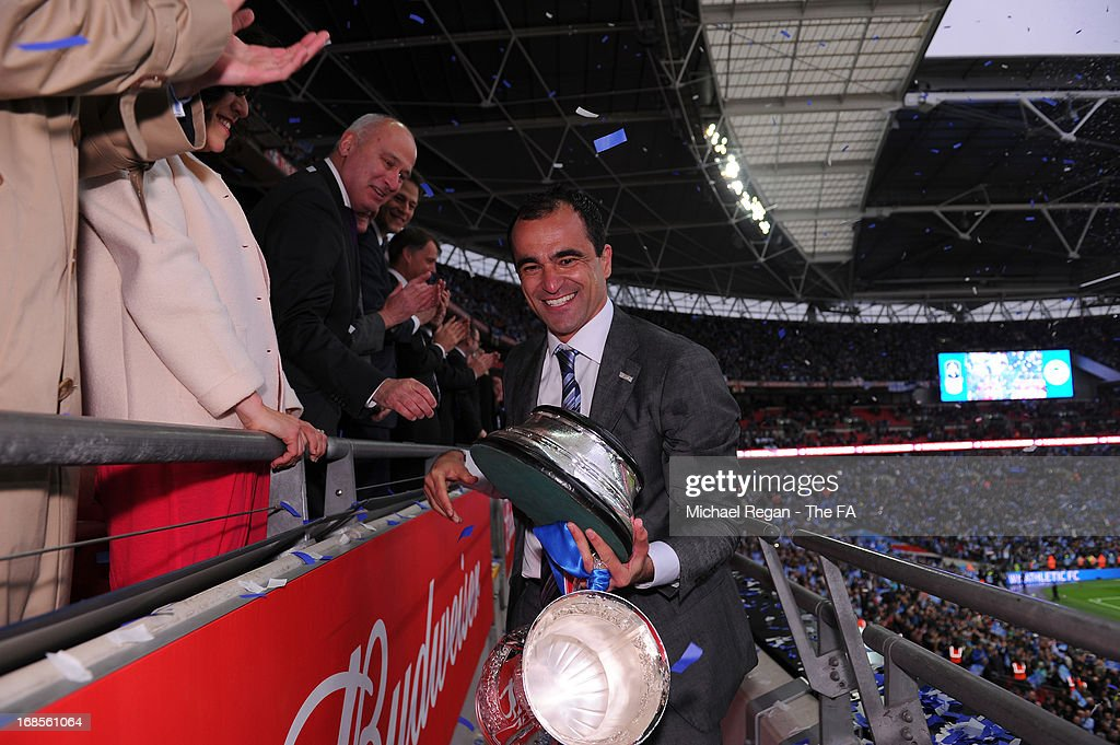 Manager Roberto Martinez of Wigan Athletic smiles as he is presented the FA Cup trophy during the FA Cup with Budweiser Final match between Manchester City and Wigan Athletic at Wembley Stadium on May 11, 2013 in London, England.