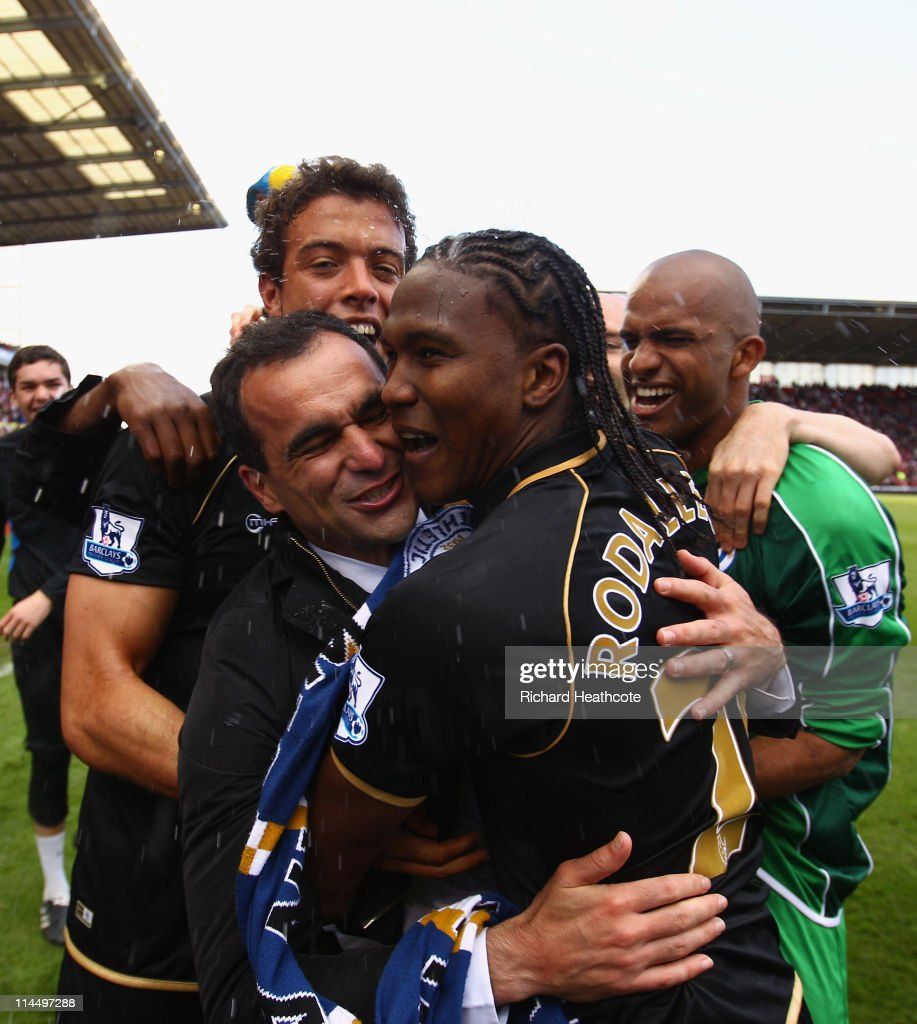 Manager Roberto Martinez of Wigan celebrates with <a gi-track='captionPersonalityLinkClicked' href=/galleries/search?phrase=Hugo+Rodallega&family=editorial&specificpeople=597054 ng-click='$event.stopPropagation()'>Hugo Rodallega</a> after victory during the Barclays Premier League match between Stoke City and Wigan Athletic at Britannia Stadium on May 22, 2011 in Stoke on Trent, England.