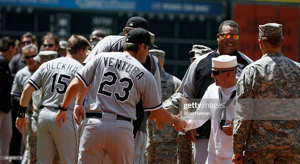 Manager Robin Ventura #23 of the Chicago White Sox greets serviceman during Military Appreciation Day before their game against the Houston Astros at Minute Maid Park on May 17, 2014 in Houston, Texas.