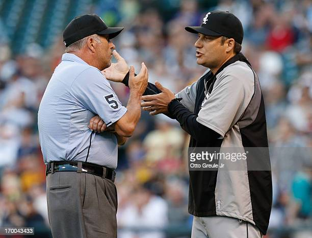 Manager Robin Ventura of the Chicago White Sox pleads with third base umpire Dale Scott after Nick Franklin of the Seattle Mariners was awarded a...