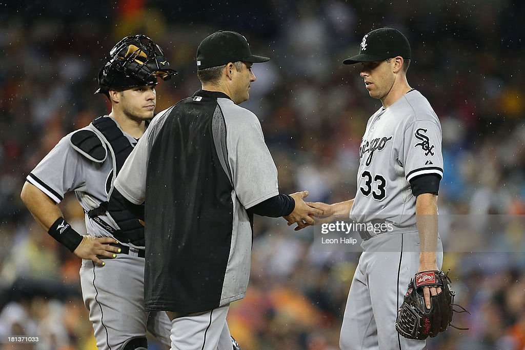 Manager <a gi-track='captionPersonalityLinkClicked' href=/galleries/search?phrase=Robin+Ventura&family=editorial&specificpeople=211486 ng-click='$event.stopPropagation()'>Robin Ventura</a> #23 of the Chicago White Soxs takes pitcher Dylan Axelrod #33 out of the game in the third inning against the Detroit Tigers at Comerica Park on September 20, 2013 in Detroit, Michigan.
