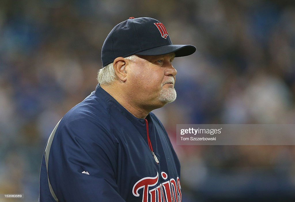 Manager Ron Gardenhire #35 of the Minnesota Twins makes a trip to the mound during MLB game action against the Toronto Blue Jays on October 3, 2012 at Rogers Centre in Toronto, Ontario, Canada.