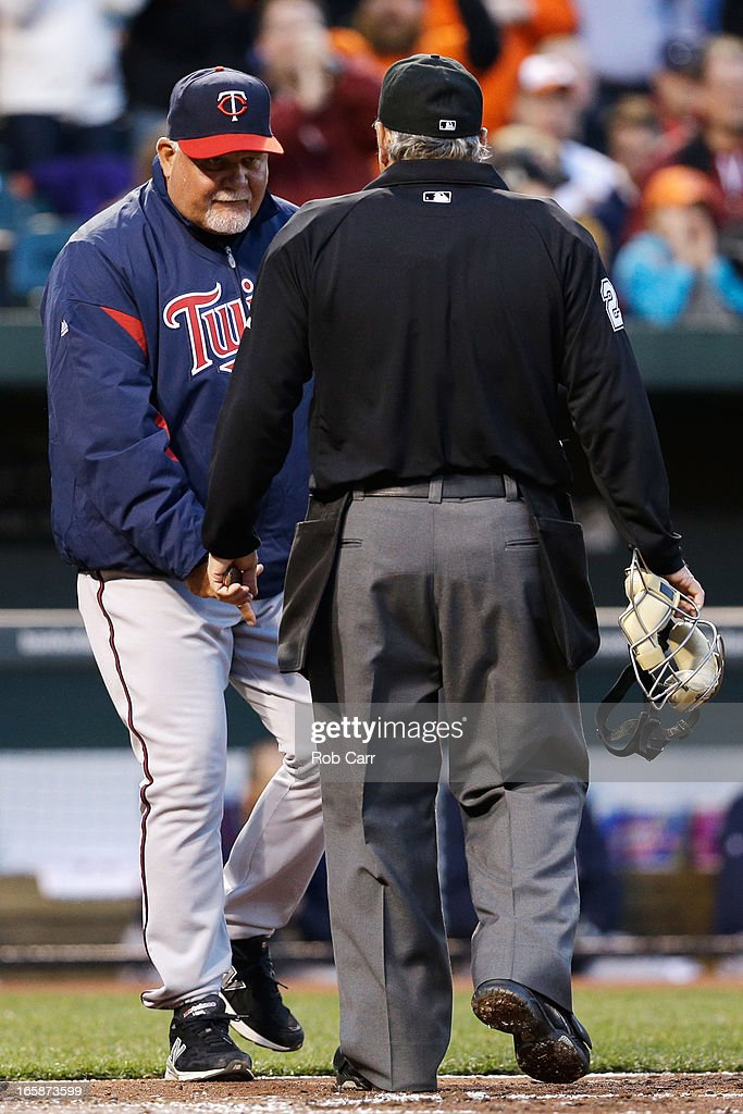 Manager <a gi-track='captionPersonalityLinkClicked' href=/galleries/search?phrase=Ron+Gardenhire&family=editorial&specificpeople=220870 ng-click='$event.stopPropagation()'>Ron Gardenhire</a> #35 of the Minnesota Twins questions a first inning call by home plate umpire Tom Hallion against the Baltimore Orioles at Oriole Park at Camden Yards on April 6, 2013 in Baltimore, Maryland.